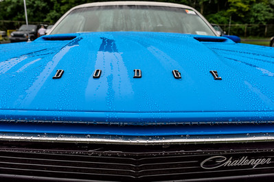 A Dodge Challenger on a rainy Saturday morning at the Carlisle All-Chrysler Nationals.