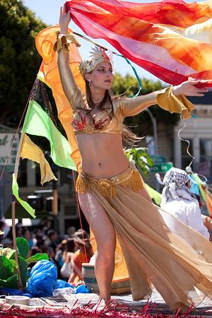 "Rasa Vitalia, Fire Goddess, dancing on the float.<br /> <br /> Photo by Alan S. Yatagai,  <a href=""http://www.asyphotography.com"">http://www.asyphotography.com</a>"