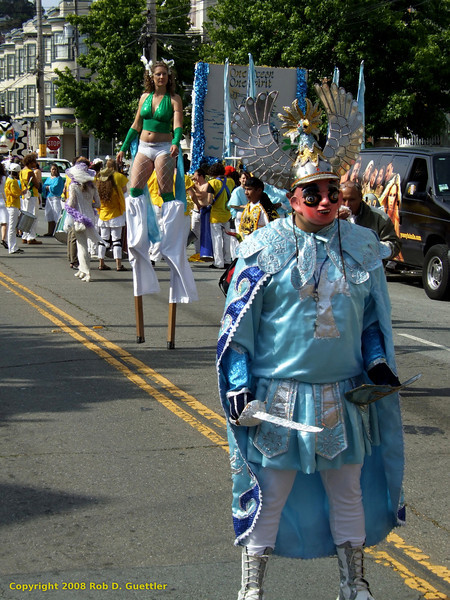 Blue and white costumed marcher. Bolivians of Southern California?, Carnaval Parade 2008 staging. Bryant St. near 24th St., Mission District, San Francisco, California.