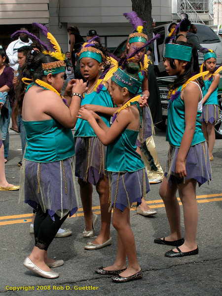 Young dancers prepare. Carnaval Parade 2008 staging. Bryant St. near 24th St., Mission District, San Francisco, California.