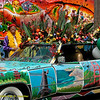 Man with photo car, plants and mural. Carnaval Parade 2008 staging. Bryant St. near 24th St., Mission District, San Francisco, California.
