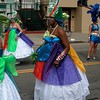 Marchers in colorful full gowns. Fogo Na Roupa, Carnaval Parade 2008 staging. Bryant St. near 24th St., Mission District, San Francisco, California.