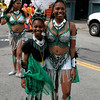 Two dancers pose. Brazivedas, Carnaval Parade 2008 staging. Bryant St. near 24th St., Mission District, San Francisco, California.