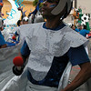 Helmeted drummer in silver. Fogo Na Roupa, Carnaval Parade 2008 staging. Bryant St. near 24th St., Mission District, San Francisco, California.