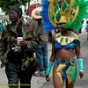 Photographer and dancer. Carnaval Parade 2008 staging. Bryant St. near 24th St., Mission District, San Francisco, California.