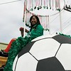 Stringing beads on float against sky. California Soccer Association North?, Carnaval Parade 2008 staging. Bryant St. near 24th St., Mission District, San Francisco, California.