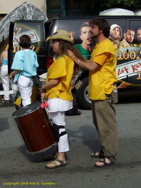 Drummer massage. Samba do Mar, Carnaval Parade 2008 staging. Bryant St. near 24th St., Mission District, San Francisco, California.