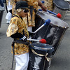 Small drummer with drum line. Loco Bloco, Mission Girls & Leonard Flynn Elementary School; Carnaval Parade 2008 staging. Bryant St. near 24th St., Mission District, San Francisco, California.