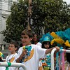 Child with bubble gun on float. Samba Mundial, Carnaval Parade 2008 staging. Bryant St. near 24th St., Mission District, San Francisco, California.