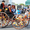 Participants power a fall-decorated quadcycle built for two during the Maple Leaf Parade Saturday morning, Oct. 19, 2013, on the Carthage Square.<br /> Globe | T. Rob Brown
