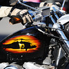 A custom paint job on a veteran's motorcycle depicts a helicopter at sunset as it travels on the Carthage Square during the Maple Leaf Parade Saturday morning, Oct. 19, 2013.<br /> Globe | T. Rob Brown