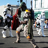 Star Wars bounty hunter Boba Fett (center) stops to strike a combat pose as the 501st Legion (Vader's Fist) group from Southwest Missouri marches during the Maple Leaf Parade Saturday morning, Oct. 19, 2013, on the Carthage Square.<br /> Globe | T. Rob Brown