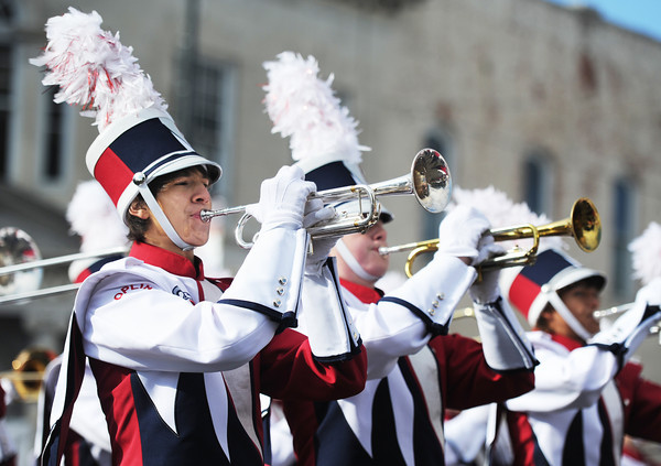 Joplin High School Marching Eagles trumpet players perform as they march down the Carthage Square during the Maple Leaf Parade Saturday morning, Oct. 19, 2013.<br /> Globe | T. Rob Brown