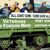 Members of Carthage's VFW Post 2590 ride a tracked military vehicle down the Carthage Square during the Maple Leaf Parade Saturday morning, Oct. 19, 2013.<br /> Globe | T. Rob Brown