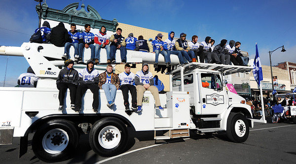 Carthage High School football players ride on a Carthage Water & Electric Plant vehicle during the Maple Leaf Parade Saturday morning, Oct. 19, 2013, on the Carthage Square.<br /> Globe | T. Rob Brown