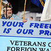 """A participant hooked up to oxygen on the VFW Post 5293 float holds onto the side of the float which reads, """"Your freedom is our pride,"""" during the Maple Leaf Parade Saturday morning, Oct. 19, 2013, on the Carthage Square.<br /> Globe 