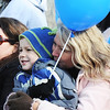 Joyce Morris of Carthage holds her 5-year-old son Jedidiah Morris as they watch the Maple Leaf Parade Saturday morning, Oct. 19, 2013, on the Carthage Square.<br /> Globe | T. Rob Brown