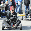 Members of a Shrine Club ride go-karts around the Carthage Square during the Maple Leaf Parade Saturday morning, Oct. 19, 2013.<br /> Globe | T. Rob Brown