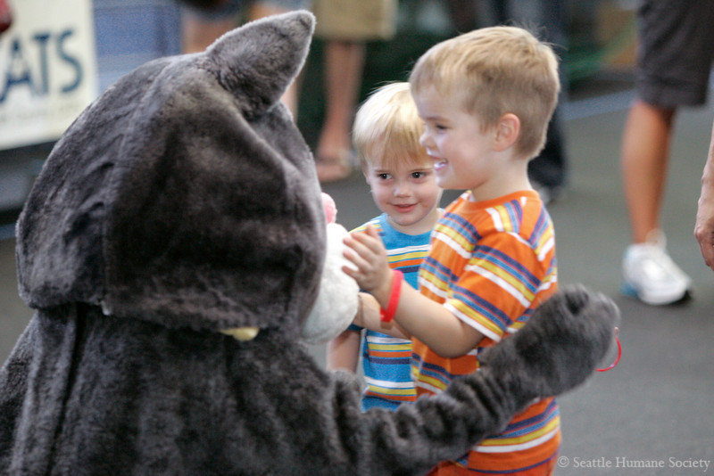 """8/14/10 -- Seattle Humane Society Catapalooza event.  Henry and William say """"Hi"""" to the SHS mascot. photographer: Dominique Riley"""