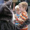 "8/14/10 -- Seattle Humane Society Catapalooza event.  Henry and William say ""Hi"" to the SHS mascot. photographer: Dominique Riley"