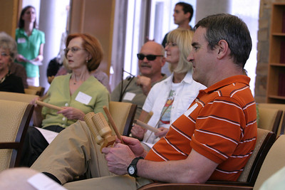 John Walsh of St. Thomas More Church, Decatur, and other Catholic Earth Day Celebration participants join in with percussion instruments during an opening session of music and song.