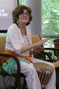 Playing a West African drum known as a dgembe, Janet Wells of Sacred Heart Basilica, Atlanta, leads participants at the St. Ignatius Chapel in an opening session of music and song.