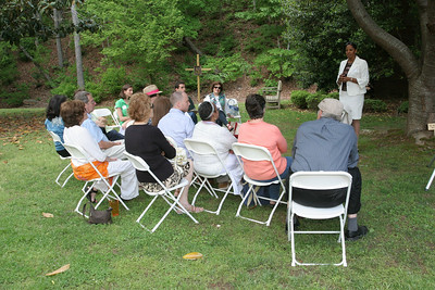 During one of three breakout sessions at the Catholic Earth Day Celebration, Donnetta Pearson of Lithia Springs, standing, shares her experiences as a victim of the historic September 2009 flood. Pearson and her family were assisted by Catholic Charities Atlanta.