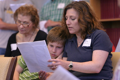 Amy Edwards, right, and her 10-year-old son Gabriel pray with others during the Catholic Earth Day Celebration at the Ignatius House Retreat Center, Atlanta, April 25.
