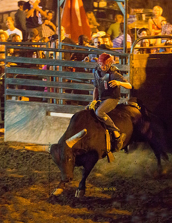 Bull rider rocks flying 3511
