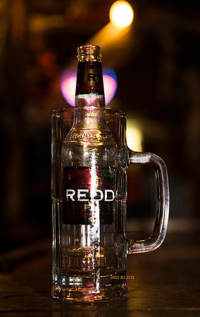 beer bottle in mug 4590