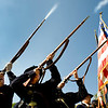 """(From left to right)  Private Rolan, Corporate Gary Mitchell (center) and Private Alec Huggins (far right) of the First Colorado Infantry, Company D, shoot off their rifles during the parade at the 53rd annual Celebrate Lafayette event in downtown Lafayette Saturday, Sept. 26, 2009. The festival has been held every year since 1956, and this year's theme was """"Hollywood on Parade"""".<br /> KASIA BROUSSALIAN / THE CAMERA"""