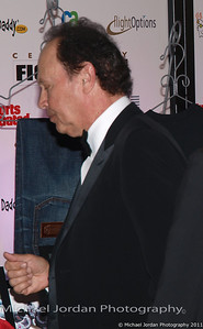 Billy Crystal arrives on the red carpet during the Muhammad Ali Celebrity Fight Night XVII at JW Marriott Desert Ridge Resort & Spa in Phoenix on Saturday, March 19, 2011.