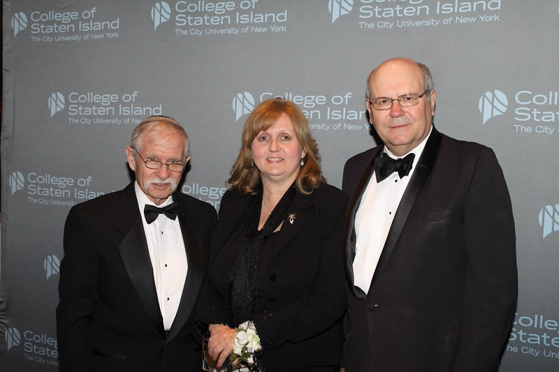 Linda M. Baran is joined by Dr. Fred Naider (left) and CSI President Dr. William J. Fritz