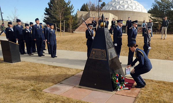 "Cadet Liz Notary places a photo of the Challenger crew at the Ellison Onizuka Memorial during the ceremony. Onizuka was a CU graduate.<br /> Air Force ROTC cadets at the University of Colorado held a memorial to honor the crews of Challenger and Columbia space shuttle disasters on Saturday on campus. For more photos and a video of the ceremony, go to  <a href=""http://www.dailycamera.com"">http://www.dailycamera.com</a>.<br /> Cliff Grassmick/ January 29, 2011"