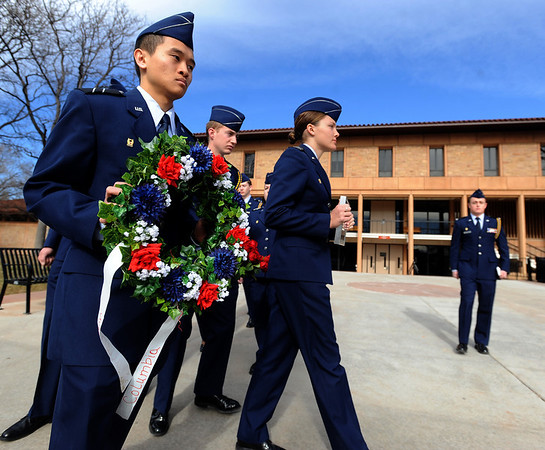 """Cadets, John Nguyen, left, and Liz Notary, lead Air Force ROTC members to the Ellison Onizuka and Chalenger Memorials.<br /> Air Force ROTC cadets at the University of Colorado held a memorial to honor the crews of Challenger and Columbia space shuttle disasters on Saturday on campus. For more photos and a video of the ceremony, go to  <a href=""""http://www.dailycamera.com"""">http://www.dailycamera.com</a>.<br /> Cliff Grassmick/ January 29, 2011"""