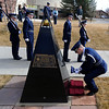 "Cadet Kyle Haney places a US Flag at the Ellison Onizuka Memorial during the ceremony. Onizuka was a CU graduate.<br /> Air Force ROTC cadets at the University of Colorado held a memorial to honor the crews of Challenger and Columbia space shuttle disasters on Saturday on campus. For more photos and a video of the ceremony, go to  <a href=""http://www.dailycamera.com"">http://www.dailycamera.com</a>.<br /> Cliff Grassmick/ January 29, 2011"