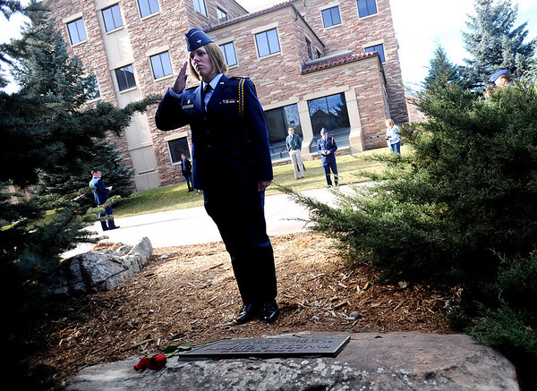"Cadet  Katie Hartman salutes the Ellison Onizuka memorial stone after placing a rose on it. Onizuka was a CU graduate.<br /> Air Force ROTC cadets at the University of Colorado held a memorial to honor the crews of Challenger and Columbia space shuttle disasters on Saturday on campus. For more photos and a video of the ceremony, go to  <a href=""http://www.dailycamera.com"">http://www.dailycamera.com</a>.<br /> Cliff Grassmick/ January 29, 2011"
