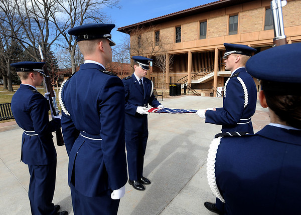 """Matt Sanders, left, and Thomas Konnert, unfold the flag during the ceremony.<br /> Air Force ROTC cadets at the University of Colorado held a memorial to honor the crews of Challenger and Columbia space shuttle disasters on Saturday on campus. For more photos and a video of the ceremony, go to  <a href=""""http://www.dailycamera.com"""">http://www.dailycamera.com</a>.<br /> Cliff Grassmick/ January 29, 2011"""