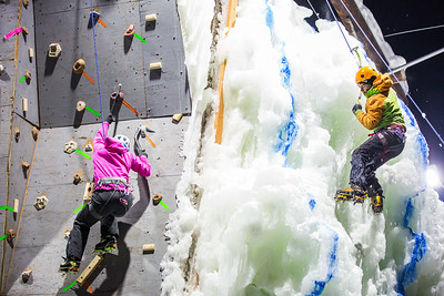Students compete in a ice climbing competition during Winter Carnival on campus.