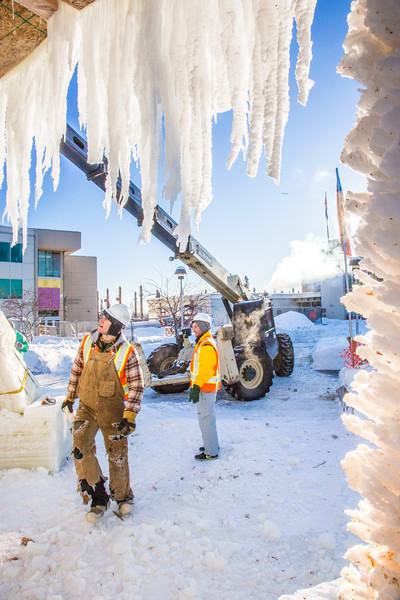 Volunteers from GHEMM, Inc. use a crane to lift the buttresses for this year's student-built ice arch into position in Cornerstone Plaza on campus. The annual ice arch is designed and built by a team of engineering students, a UAF tradition going back more than 60 years.