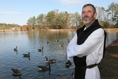 Abbot Francis Michael Stiteler, OCSO, stands along the banks of the lake at the Monastery of the Holy Spirit, Conyers.