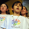 "Eli Galdieri, 5, sings with other members of the Boulder Jewish Day School Choir during  the ""ChanuConcert: A Musical Celebration of Lights"" at the Congregation Har HaShem in Boulder on Sunday.<br /> Cliff Grassmick / December 13, 2009"