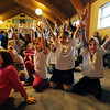 """Kids follow the instructions from Jeff Kagan during  the """"ChanuConcert: A Musical Celebration of Lights"""" at the Congregation Har HaShem in Boulder on Sunday.<br /> For a photo gallery and video of the event, go to  <a href=""""http://www.dailycamera.com"""">http://www.dailycamera.com</a><br /> Cliff Grassmick / December 13, 2009"""