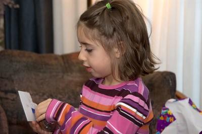 Rebecca opens a card   (Nov 26, 2004, 03:17pm)