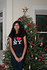Ms Tarika in front of the Christmas tree she decorated