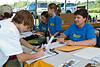 Erik James (age 13) of Essex registers with Wendy King for the bike race - Changing Gears Changing Lives charity event in Williston VT on Saturday, August 15, 2009. (HARJIT DHALIWAL)
