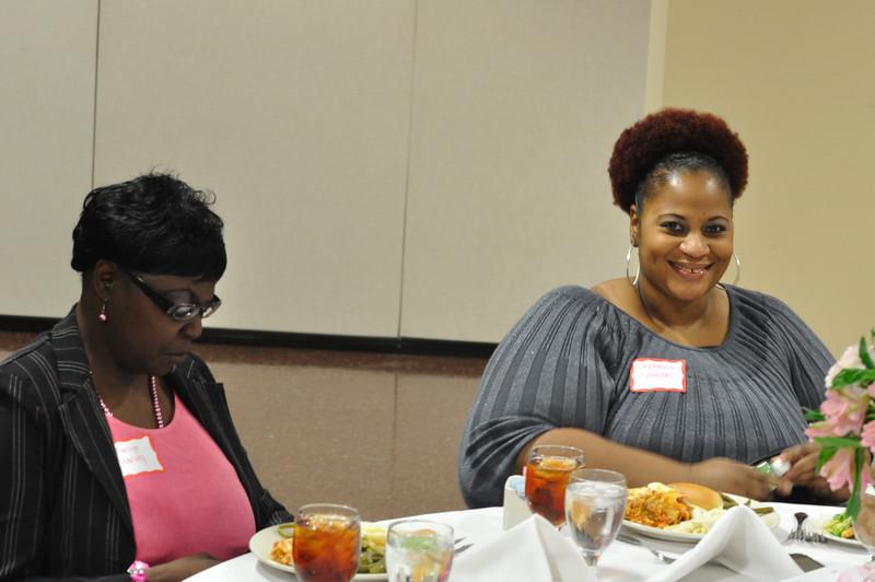 Marilyn Harvey and LaWanda Johnson prepare to enjoy their meal.