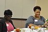 Marilyn Harvey and LaWanda Johnson prepare to enjoy their meal.