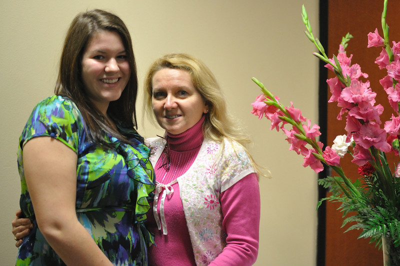 Carly poses with Mrs. Shelley Hill, who graciously donated the floral arrangements.