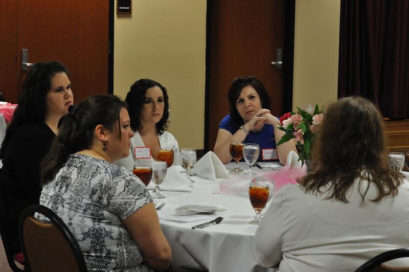KE members listen intently to a survivor.